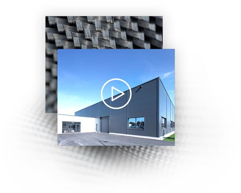 Graues Firmengebäude der Nieke Composites GmbH. Auf der Fassade ist das Logo abgebildet.